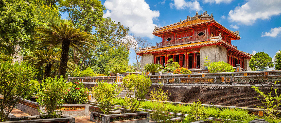 Minh Mang Emperor Tomb in Hue, Vietnam with surrounding greenery